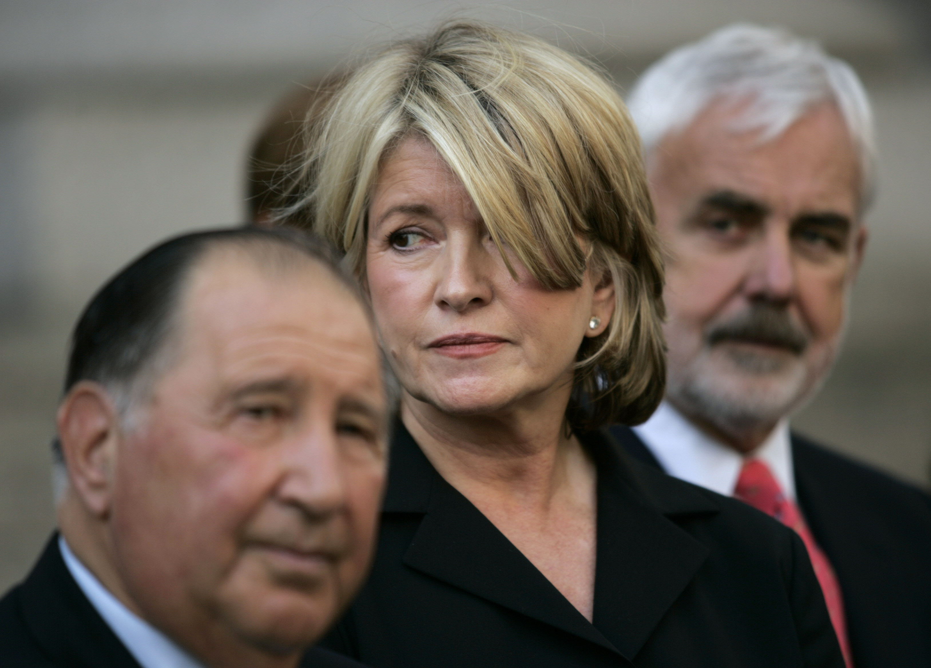Martha Stewart is flanked by her lawyers Robert Morvillo, left, and John Tigue, outside Manhattan federal court after her sentencing, in New York Friday July 16, 2004. Stewart was sentenced Friday to five months in prison and five months of home confinement for lying about a stock sale. (AP Photo/John Marshal Mantel)
