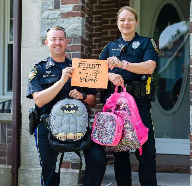 Officer Henry Cadett and Officer Megan Baur prepare for the start of the school year in Wallingford, August 27, 2018.