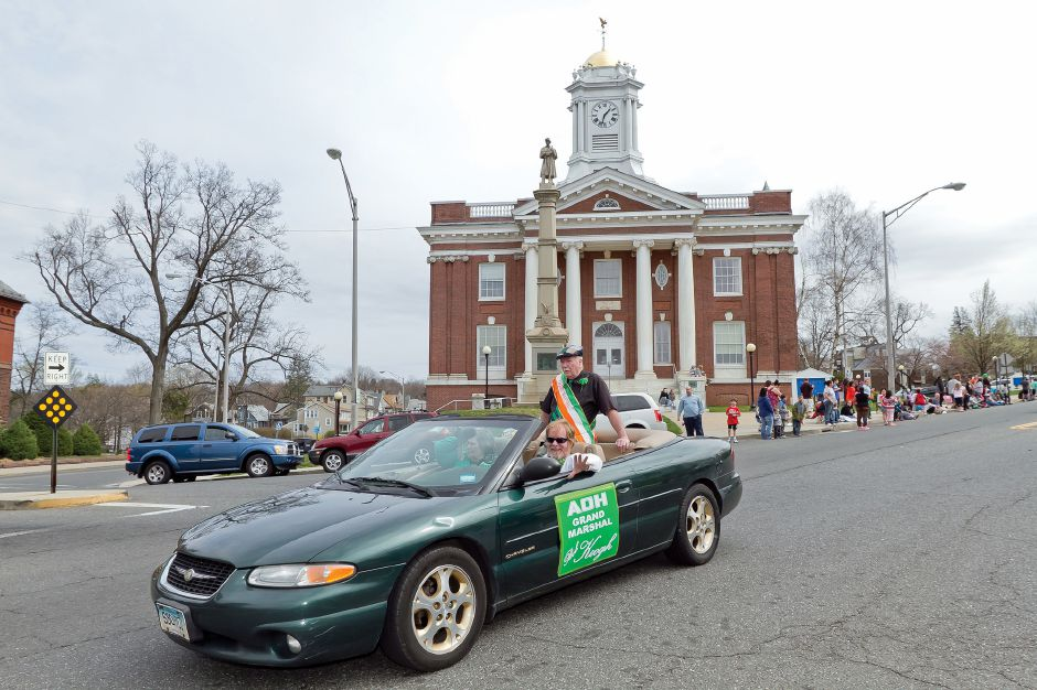 Grand Marshal Bob Keogh rides in the St. Patrick