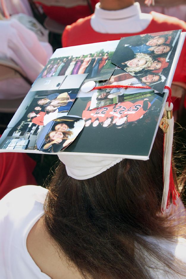 Cheshire graduating senior Meredith Grossman had her mortar board decorated with photos from her time at Cheshire High Tues., June 19.