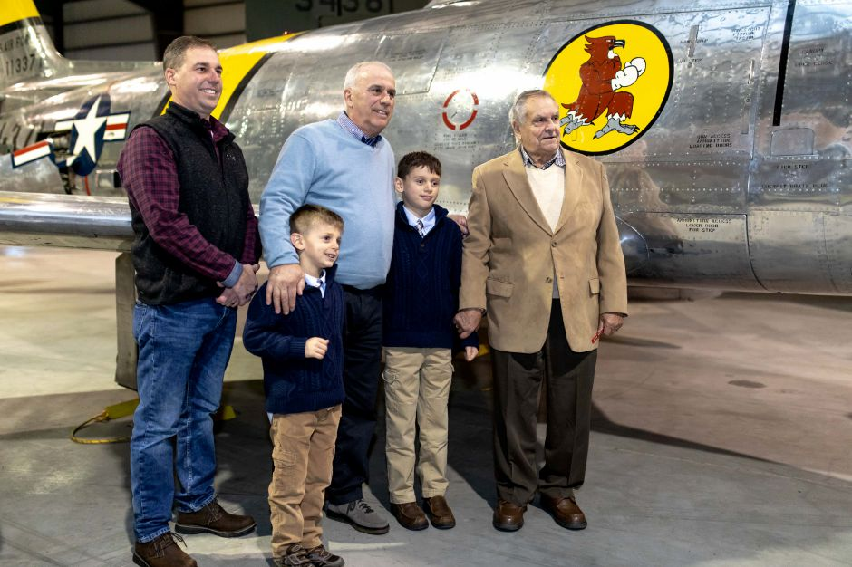 Robert Rawlings, right, of Berlin, stands in front of an Air Force F-86, the jet fighter model he flew in the Korean War. Rawlings was presented with replacement service medals at the New England Air Museum in East Granby on Nov. 27, 2018. | Devin Leith-Yessian/Berlin Citizen