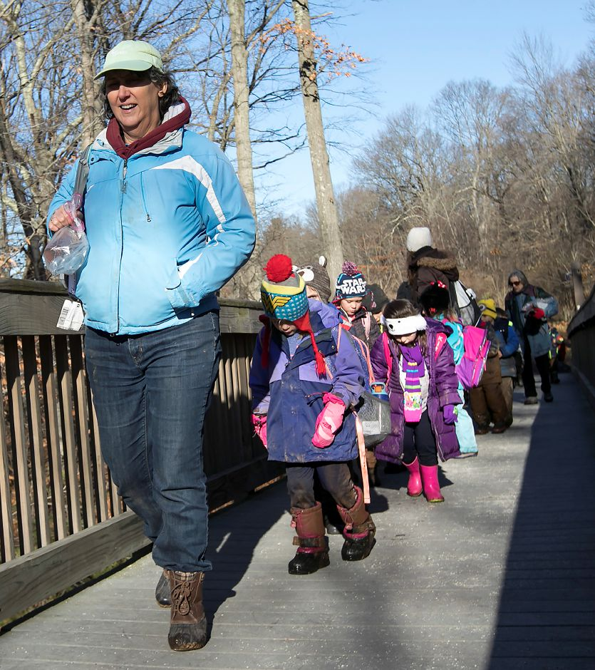 Moses Y. Beach Elementary School kindergarten teacher Adrienne Ferretti leads her class over a bridge during the Kinderwoods program at Kohler Environmental Center in Wallingford, Thursday, Dec. 7, 2017. Dave Zajac, Record-Journal