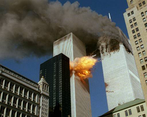 SECOND OF A SERIES OF FOUR PHOTOS---Smoke pours off one of the towers of the World Trade Center as flames explode from the second one as it is struck by a plane Tuesday, Sept. 11, 2001, after terrorists crashed planes into the buildings.  The attack collapsed both buildings. (AP Photo/Chao Soi Cheong)MANDATORY CREDIT