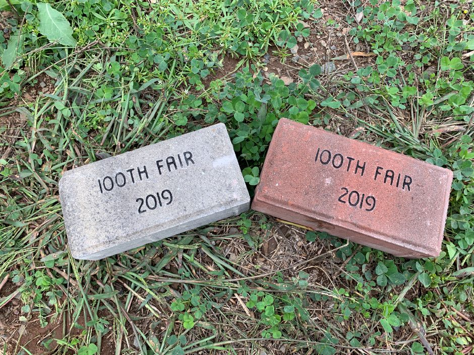 Some of the commemorative bricks that will be laid at the site of the tribute. Others will include the names of donors, their families and loved ones. Photo by Everett Bishop, Town Times.