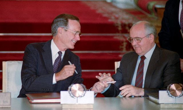 "FILE - In this file photo taken Wednesday, Aug. 1, 1991, U.S. President George H. Bush and Soviet President Mikhail Gorbachev exchange pens after signing the START arms reduction treaty in the Kremlin, Moscow. Former Soviet premier Mikhail Gorbachev expressed his ""deep condolences"" Saturday Dec. 1, 2018, to the family of former U.S President George Bush and all Americans following his death, aged 94. (AP Photo/Boris Yurchenko)"