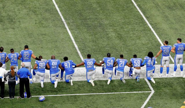 FILE - In this Sept. 24, 2017, file photo, Detroit Lions players take a knee during the national anthem before an NFL football game against the Atlanta Falcons in Detroit. President Donald Trump