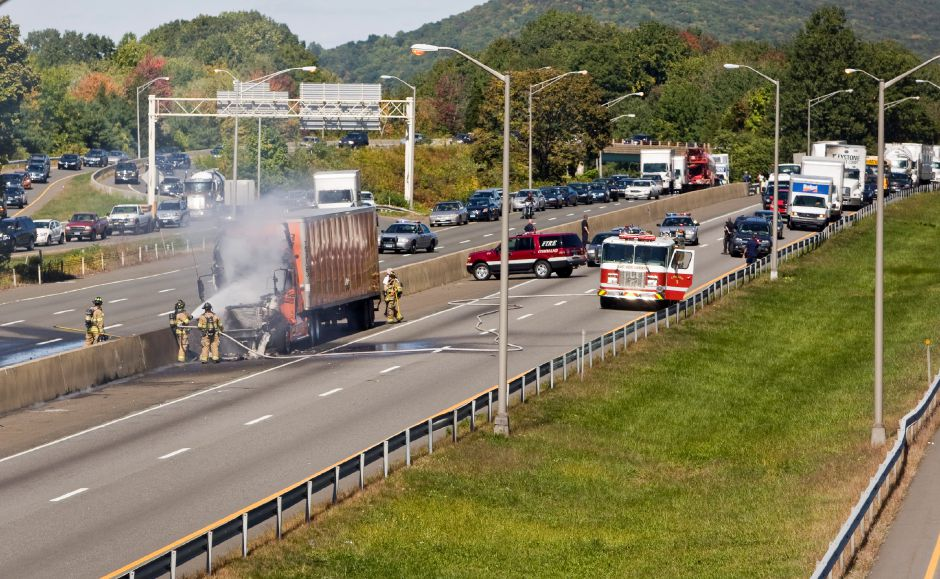 Firefighters extinguish a tractor-trailer truck that is on fire on I-91 southbound Monday afternoon in Meriden, Sept. 20, 2010. State police shutdown Route 15 South and I-91 South while firefighters fought the blaze. After being closed since approxiamately 1 p.m. some lanes on both highways were reopened by 1:40 p.m. (Christopher Zajac/Record-Journal)