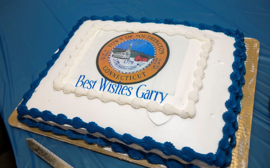A cake with the town seal honoring Garry Brumback during his retirement party at Southington Town Hall, Friday, Nov. 17, 2017. | Dave Zajac, Record-Journal
