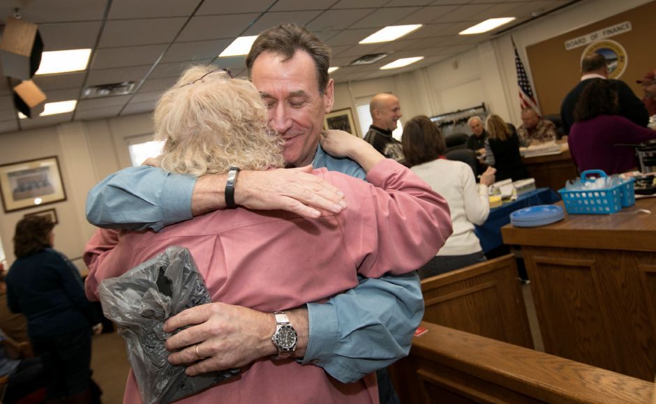 Town Manager Garry Brumback is hugged by Victoria Triano, the Republican minority leader during his retirement party at Southington Town Hall, Friday, Nov. 17, 2017. | Dave Zajac, Record-Journal