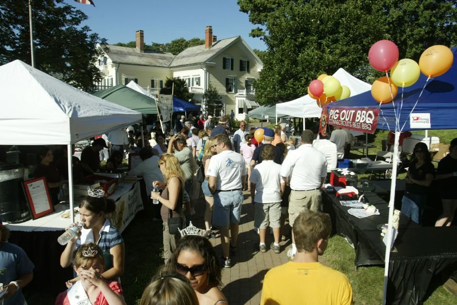 A crowd of people make their way through the row of booths on the front lawn of the Barnes Museum in Southington for the Taste of Southington on Wednesday, August 9, 2006.