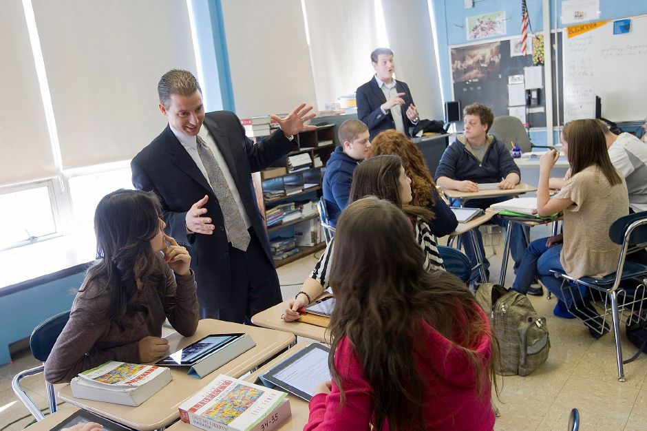 Superintendent Benigni talks with students in Geoffrey Kenyon's history class at Platt High School Wednesday January 11, 2012. The class has been using iPads throughout the year and Benigni joined them with one of his own. (Dave Zajac/Record-Journal)
