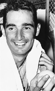 Sandy Koufax, Los Angeles Dodgers' lefthander clutches baseball as he sits in dressing room on August 29, 1961 in Chicago, after pitching a two-hitter against the Chicago Cubs to win, 2 to 1.   Victory boosted the Dodgers to within three games of the League-leading Cincinnati Redlegs. (AP Photo/Paul Cannon
