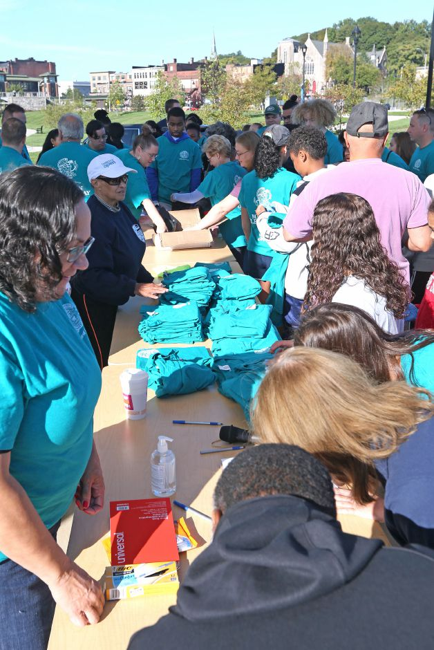 Volunteers pick up their shirts and sign in at the Meriden Green for the annual Community Cleanup Day on Saturday, Sept. 21, 2019. Emily J. Tilley, special to the Record-Journal.