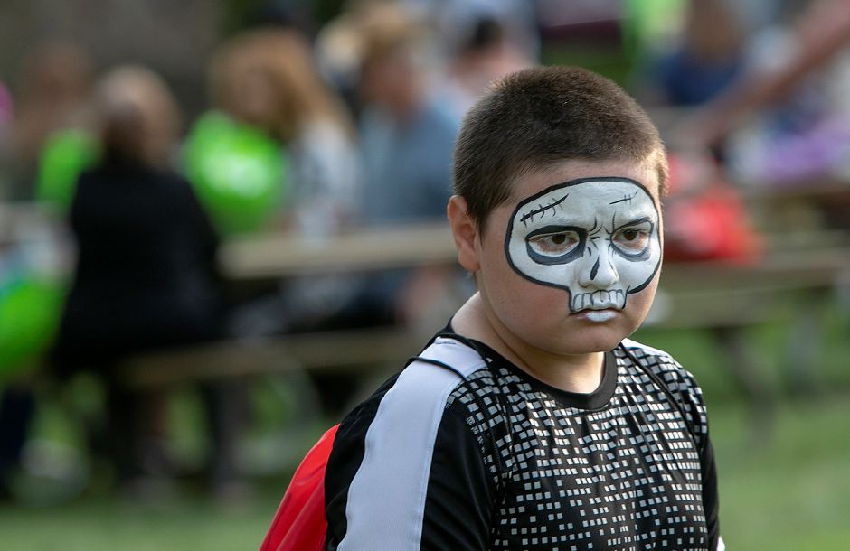 Mykel Willey, 11, of Meriden, dons a skeleton face during the 14th annual National Night Out at Hubbard Park in Meriden, Tuesday, August 7, 2018. Dave Zajac, Record-Journal