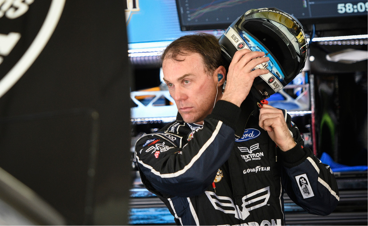 Pole winner Kevin Harvick takes his helmet off in the garage during practice for the NASCAR Monster Cup series auto race at Atlanta Motor Speedway in Hampton, Ga., Saturday, March 4, 2017. (AP Photo/John Amis)