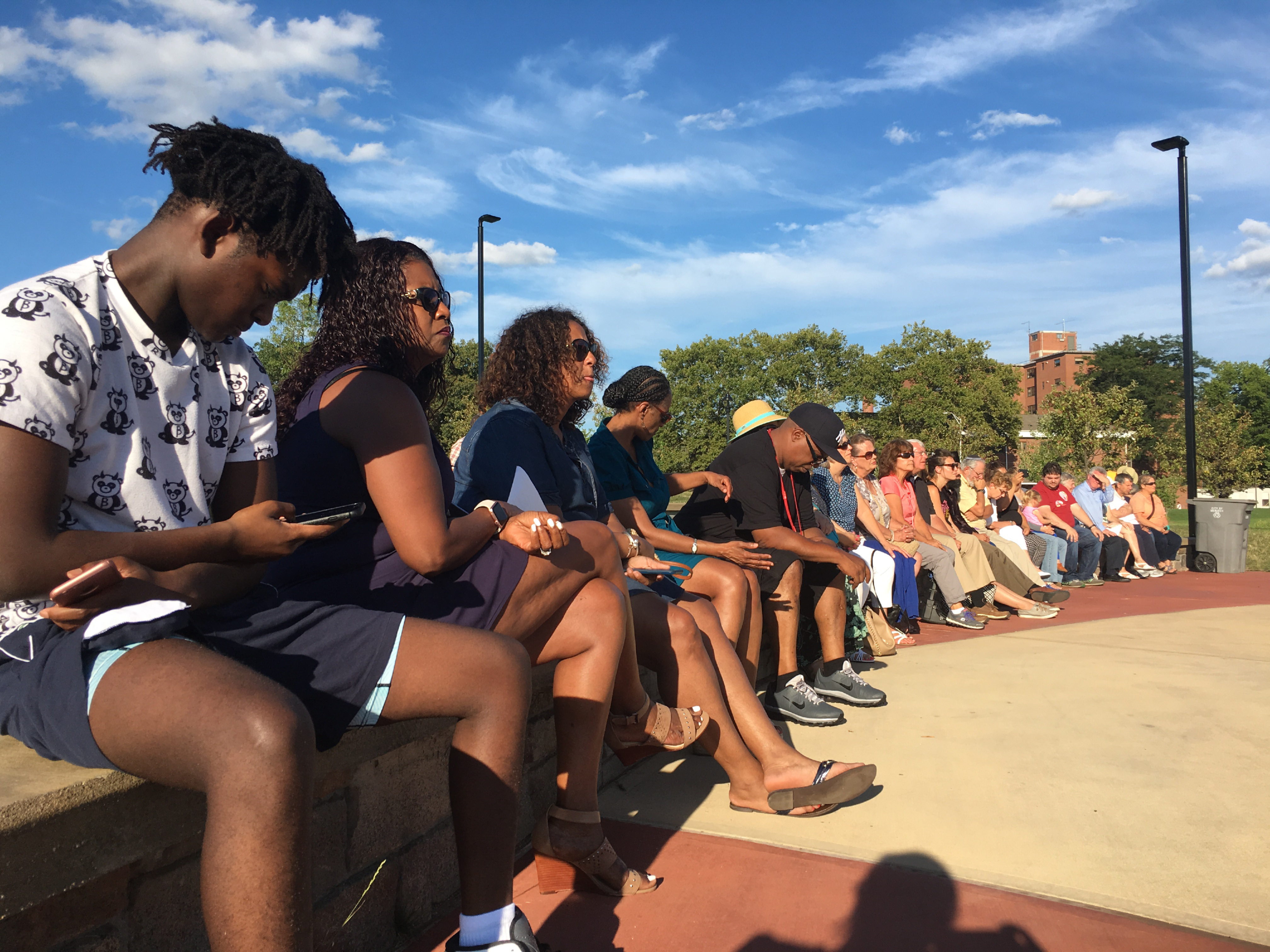 People lined the benches of the Meriden Green band shell for a peace rally hosted by area nonprofits, government and religious groups on Wednesday, Aug. 23, 2017. | Lauren Takores, Record-Journal