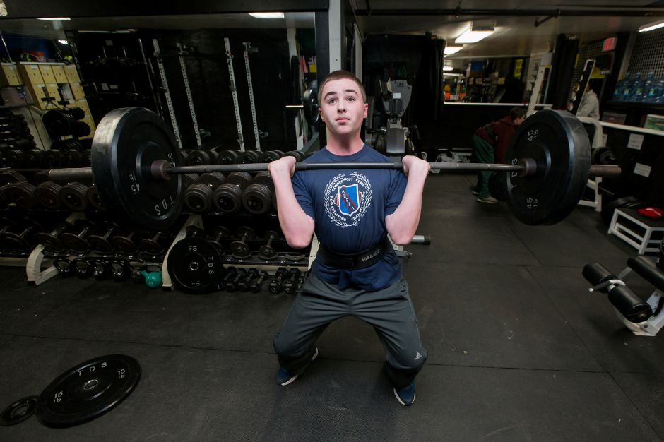 Luca Raccio, 13, of Cheshire, works out Saturday at Ultimate Sports in Wallingford. The Dodd Middle School eighth-grader set four world records for his age and weight group at a state competition last month. Justin Weekes, Special to the Record-Journal