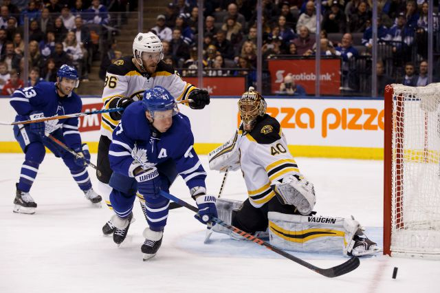 Toronto Maple Leafs center Leo Komarov (47) misses a shot on Boston Bruins goaltender Tuukka Rask (40) during the second period of an NHL hockey game Saturday, Feb. 24, 2018, in Toronto. (Cole Burston/The Canadian Press via AP)