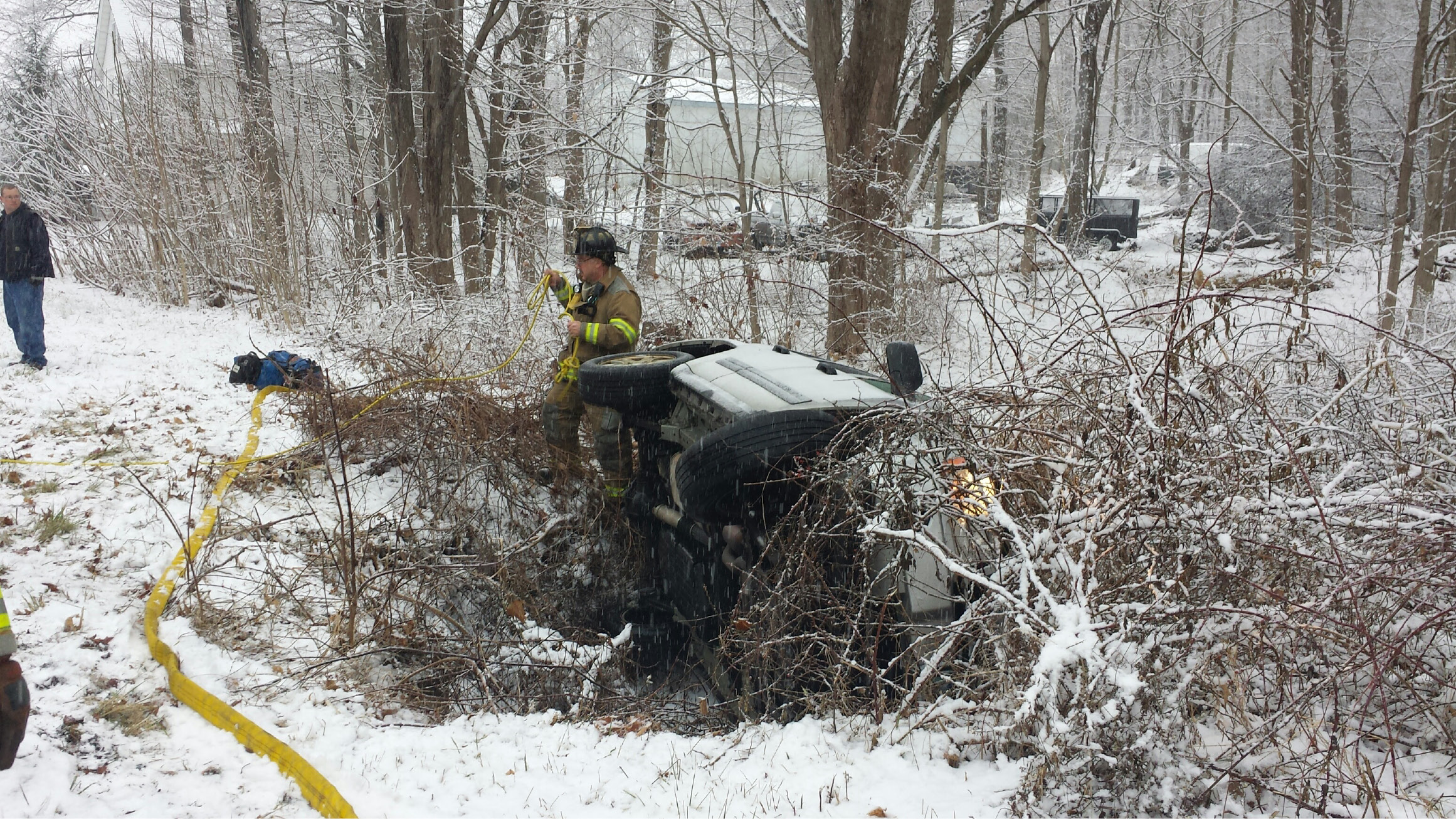 A Jeep rolled over on Hanover Avenue Monday morning due to the slippery roads from the snow. The driver was uninjured. (Lauren Sievert Record-Journal)