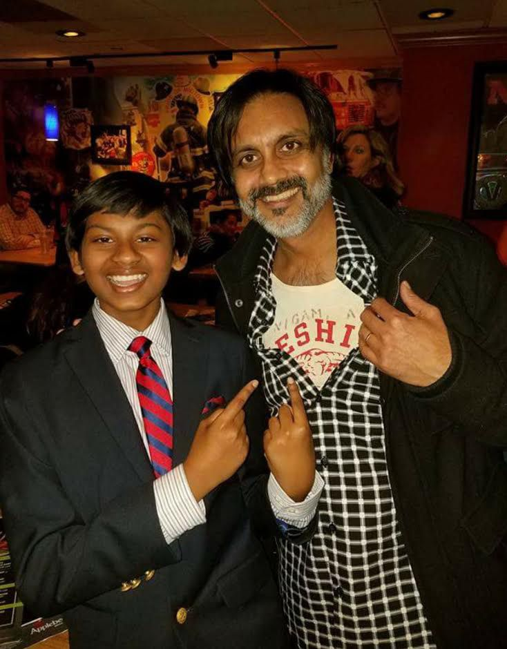 "Anjul Nigam, right, shows off his own gym shirt from Cheshire High School at the New York premiere of ""Growing Up Smith,"" an indie film written and produced by Nigam, a CHS class of 1984 grad, and starring Roni Akurati, left, on Feb. 3, 2017. 
