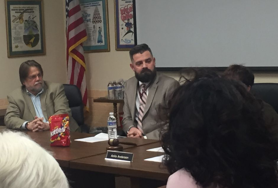 The North Haven Board of Education unanimously appoints Patrick Stirk (center), current principal of Ridge Road School, as the next superintendent of schools during a special board meeting on Thursday, Jan. 3, 2018. | Bailey Wright, Record-Journal
