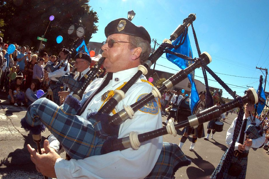 The Department of Corrections Officer Mike Stephens plays the bagpipes for the crowd at the annual Apple Harvest Festival held Sunday in Southington.