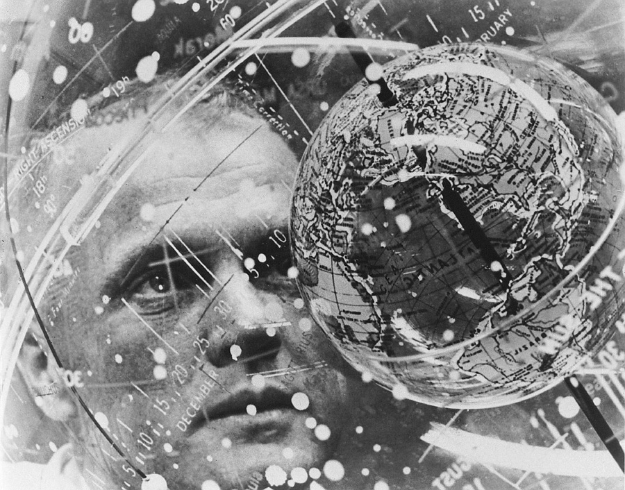 In this February 1962 photo made available by NASA, astronaut John Glenn looks into a Celestial Training Device globe at the Aeromedical Laboratory at Cape Canaveral, Fla. Glenn, the first American to orbit Earth who later spent 24 years representing Ohio in the Senate, died Thursday, Dec. 8, 2016, at the age of 95. (NASA via AP)