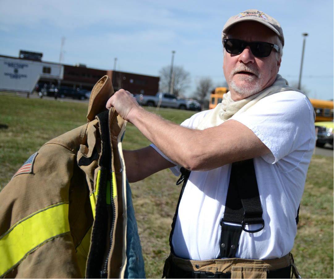 FILE PHOTO -- Southington fire board chairman Mike Bunko puts on a fire jacket prior to a fire training exercise on Monday, April 10, 2017. | Bryan Lipiner, Record-Journal