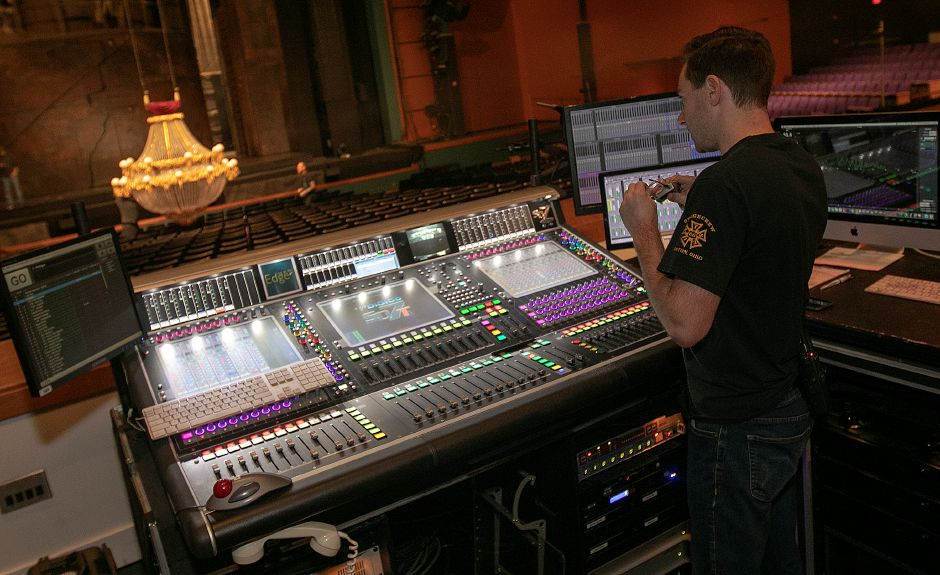 Brian Rau, head audio, checks actor