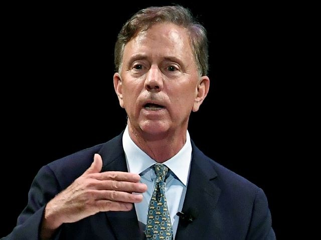 FILE - In this July 12, 2018 file photo, Democratic candidate for governor Ned Lamont speaks during a gubernatorial debate in New Haven, Conn. Lamont, his party