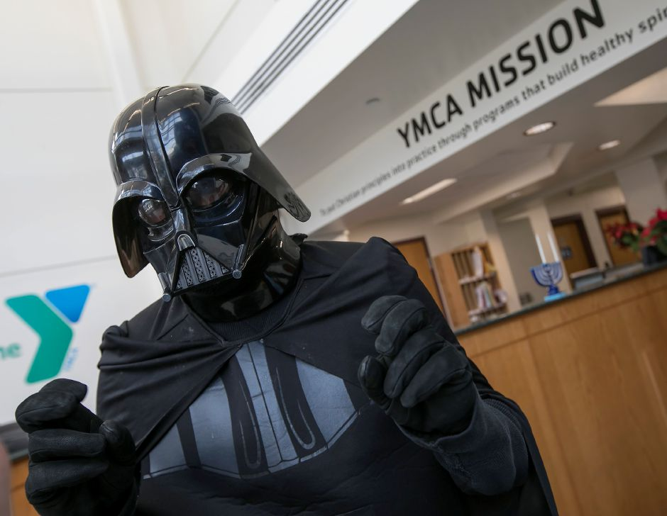 Tom Sangeloty, outdoor center program director for YMCA Camp Sloper, dons a Darth Vader costume during a gathering at the Southington YMCA, Wednesday, Dec. 13, 2017. YMCA officials announced awards for individuals and groups that contribute to the community during a Star Wars themed press conference Wednesday morning. The award winners will be honored at the YMCA celebration and recognition on Feb. 6. Dave Zajac, Record-Journal