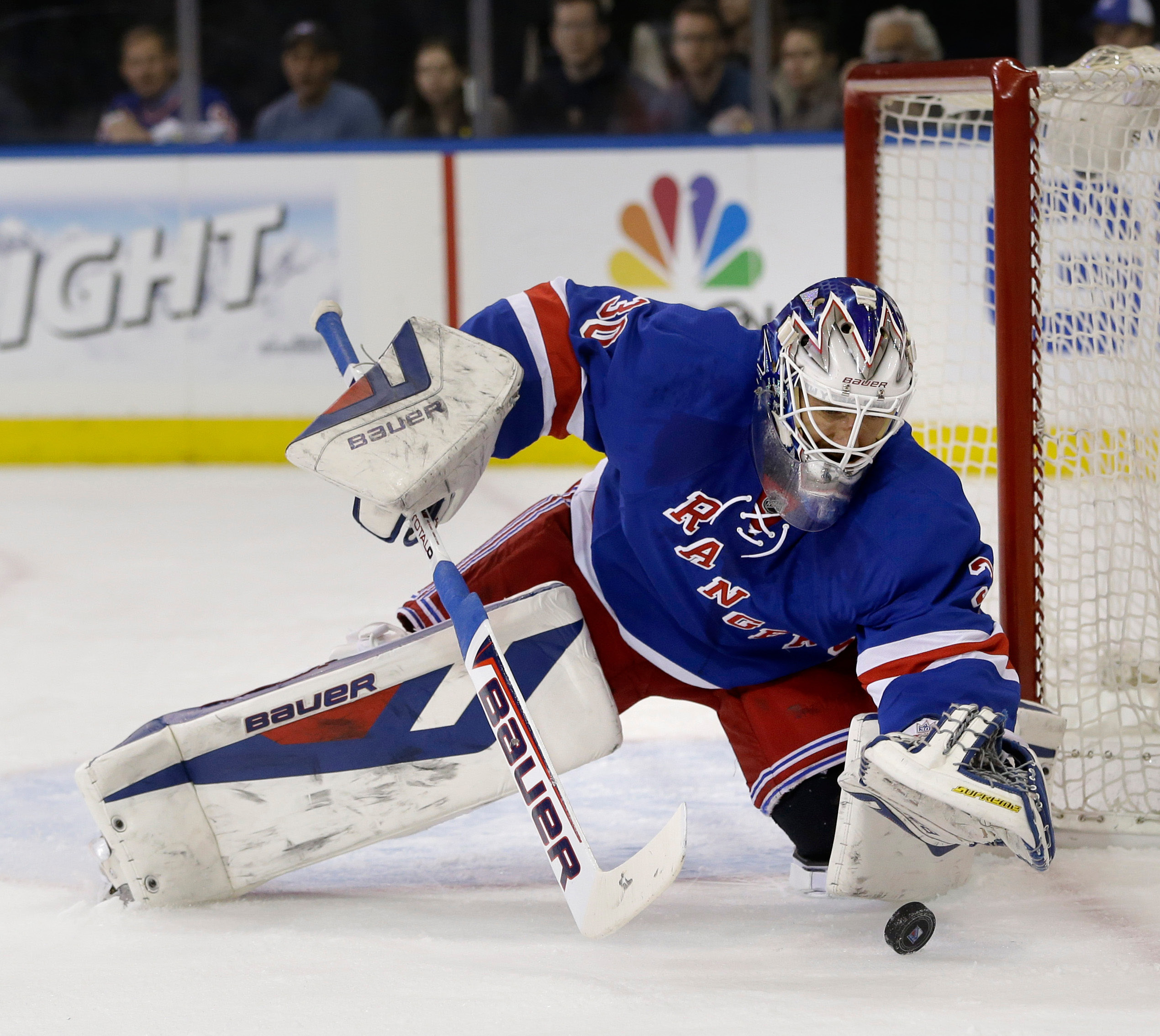 Rangers' goalie Henrik Lundqvist makes a save during the first period of Sunday's NHL playoff game against Philadelphia in New York.  | Associated Press