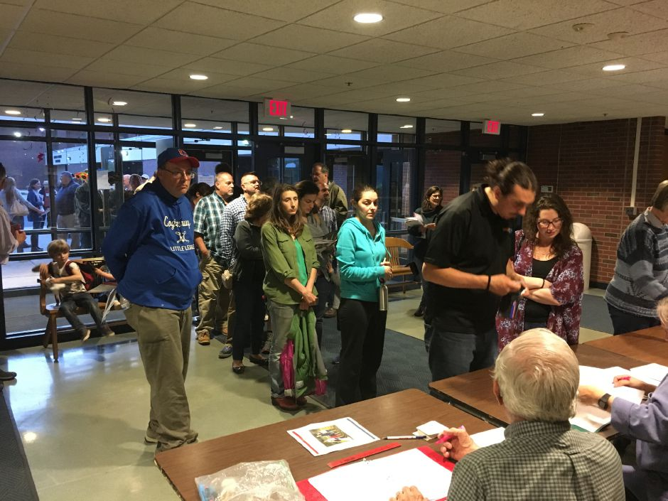 Durham voters check in for the annual town meeting at Coginchaug Regional High School on Monday, May 14, 2018. | Lauren Takores, Record-Journal