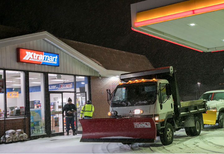 Snow crews stop at the XtraMart Shell station on East Main Street during the nor'easter Tuesday morning, March 14, 2017. | Dave Zajac, Record-Journal