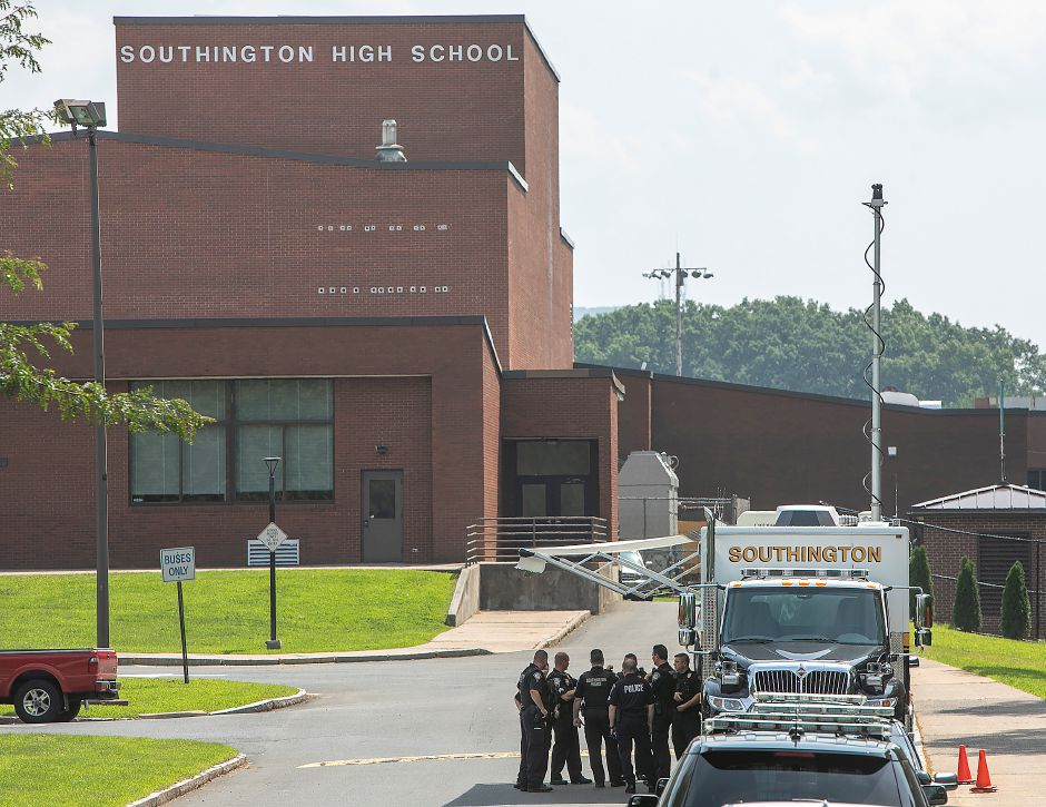 Southington police confer during a training exercise at Southington High School on Tuesday. Dave Zajac, Record-Journal