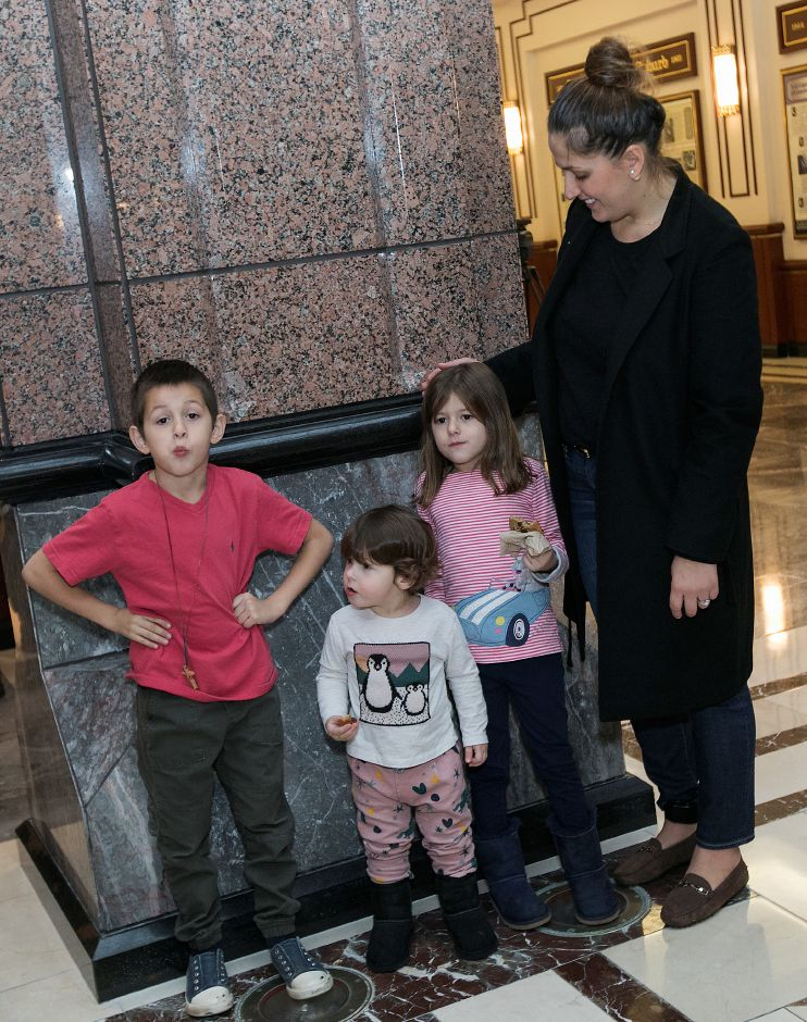 Denada Rondos and children, Niko, 7, Alexandra, 1, and Katerina, 5, gather after a press conference at the Legislative Office Building in Hartford Monday, November 13, 2017. The Department of Homeland Security issued a forbearance that stated ICE won't act to deport Denada Rondos while her appeal is being reviewed by the Second Circuit Court of Appeals. | Dave Zajac, Record-Journal