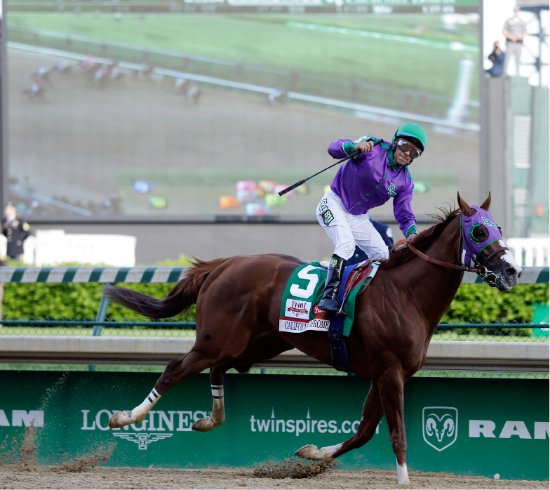 Victor Espinoza rides California Chrome to a victory during the 140th running of the Kentucky Derby horse race at Churchill Downs Saturday, May 3, 2014, in Louisville, Ky. (AP Photo/Morry Gash)