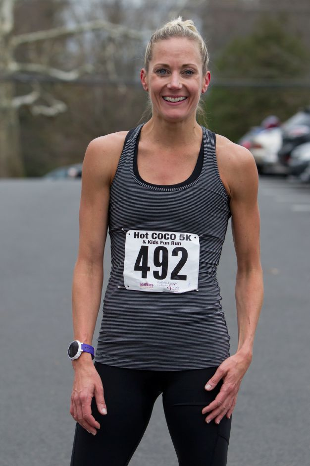 Katie Edwards of Glastonbury was the first female finisher with a time of 17:51 Saturday during the Hot Coco 5K to benefit Abilities Without Boundaries at the Norton Elementary School in Cheshire November 18, 2017 | Justin Weekes / For the Record-Journal