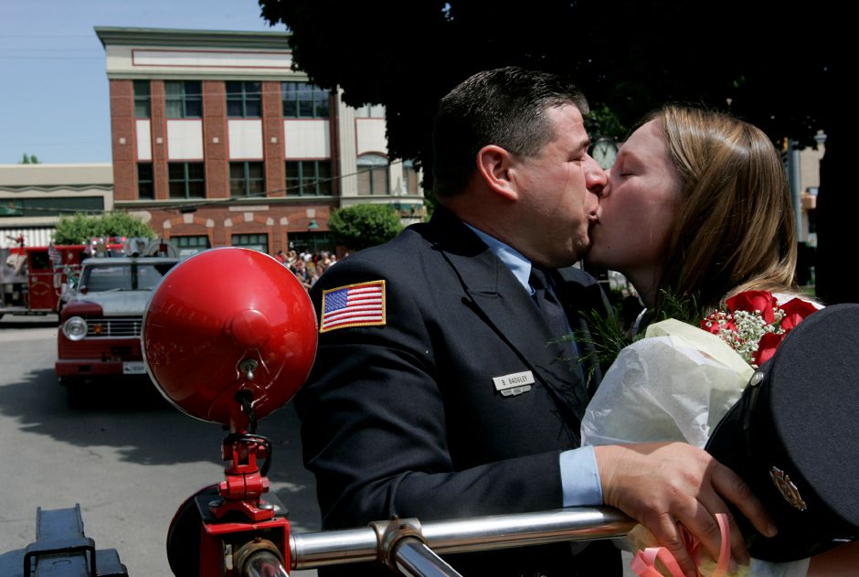 Record Journal Photo/ Johnathon Henninger 5.25.08 - Brian Badgley, 15 year Volunteer Fire Fighter with Company 2 in Plantsville, kisses his new fiance, Jocelyn Abbate, after proposing during Southington