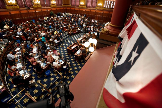 Legislators meet inside the Hall of the House during the final day of session at the State Capitol in Hartford, Conn., Wednesday June 5, 2019. (AP Photo/Jessica Hill)