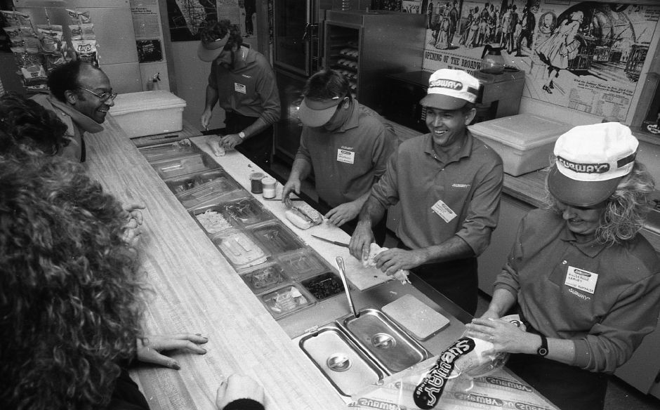RJ file photo - Anthony Harvey, Ken Sandercock, Terence Harris and Julie-Anne Harvey make sandwiches for customers at Subway Subs of Wallingford March 9, 1989. The four will return to Australia to open their own franchises later this year.