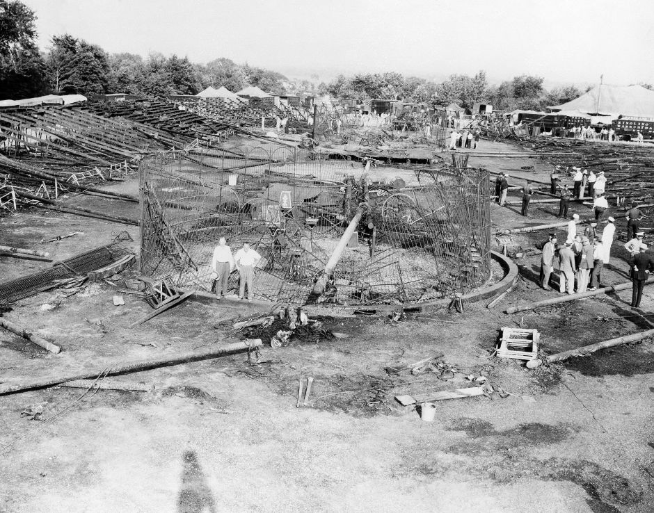 Collapsed animal rings, charred poles and bleacher seats make up the devastation a day after the circus fire in Hartford, Connecticut, shown July 7, 1944. Flames swept the big top during a performance of the Ringling Bros. and Barnum and Bailey Circus; 152 people were killed and 225 injured. (AP Photo)