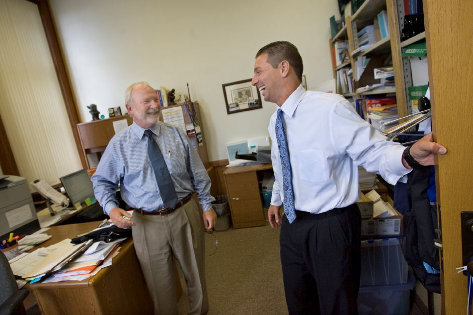Meriden School Superintendent Mark Benigni, right, smiles with Research & Evaluation Specialist Alvin F. Larson PhD, left, while visiting Meriden Board of Education staff on his first day of work July 1, 2010. (Dave Zajac/Record-Journal)