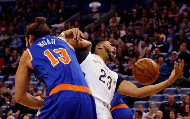 New Orleans Pelicans forward Anthony Davis (23) gets tangled up with New York Knicks center Joakim Noah (13) during a rebound in the first half of an NBA basketball game in New Orleans, Friday, Dec. 30, 2016. (AP Photo/Max Becherer)