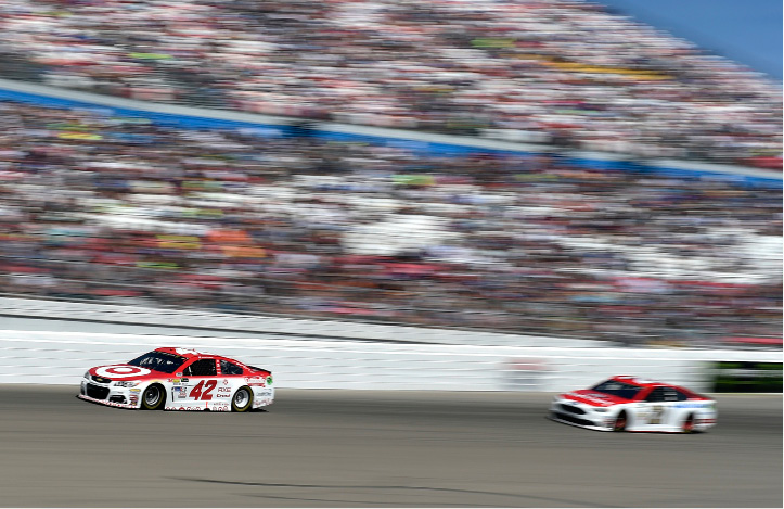 Kyle Larson (42) leads Ryan Blaney during the NASCAR Cup Series auto race Sunday, March 12, 2017, at Las Vegas Motor Speedway in Las Vegas. (AP Photo/David Becker)