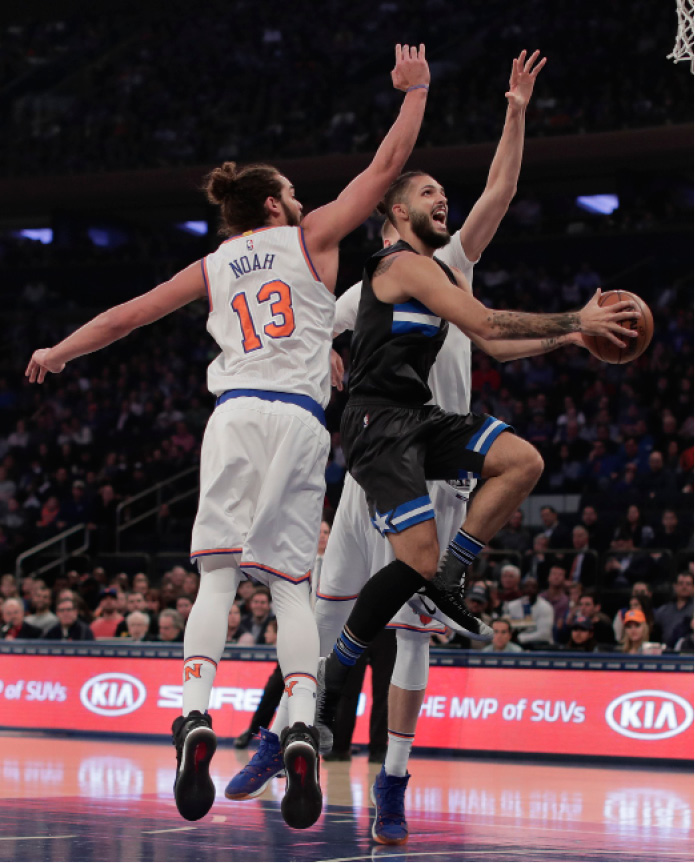 Orlando Magic guard Evan Fournier (10) goes up for a shot against New York Knicks center Joakim Noah (13) and forward Kristaps Porzingis (6) during the first quarter of an NBA basketball game, Thursday, Dec. 22, 2016, in New York. (AP Photo/Julie Jacobson)