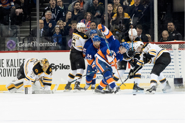 Boston Bruins goalie Anton Khudobin (35) watches as Bruins center Patrice Bergeron (37) defends the net against New York Islanders center Casey Cizikas (53) during the first period of an NHL hockey game, Saturday, March 25, 2017, in New York. (AP Photo/Mary Altaffer)