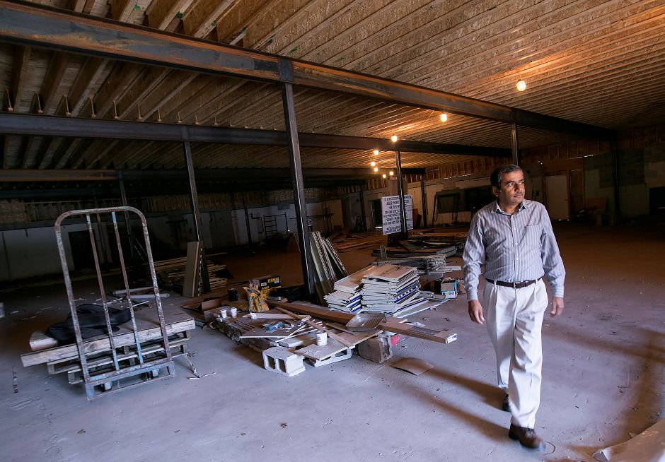 B.M. Patel, co-owner of West Side Wine and Spirits, walks through the future home of Suburban Market next door to his liquor store on Hope Hill Road in Wallingford, Wednesday, Sept. 13, 2017. Patel hopes to open Suburban Market grocery store in early 2018. | Dave Zajac, Record-Journal