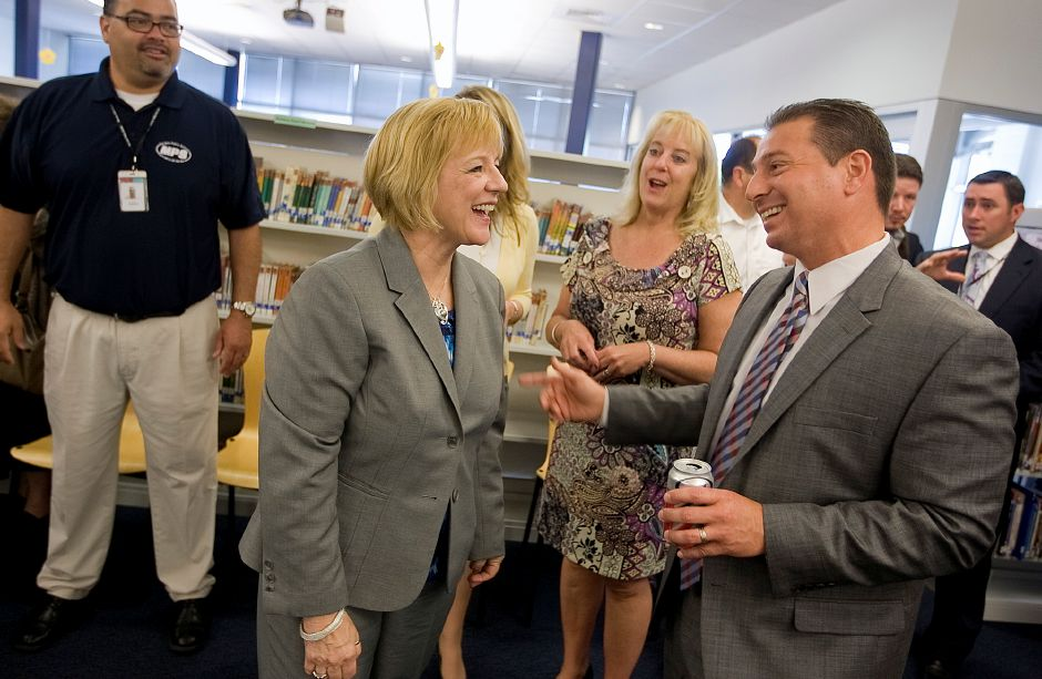 Deborah Delisle, assistant secretary for the office of elementary and secondary education at the U.S. Department of Education, Erin Benham, president of the Meriden Federation of Teachers and School Superintendent Mark D. Benigni share a few laughs while at Lincoln Middle School in Meriden, Friday, May 10, 2013. Delisle visited several city public schools, learned about new programming and spoke with community leaders. (Dave Zajac/Record-Journal)