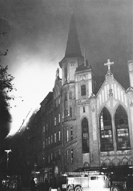 Damage done to a church and hospital in Berlin in a pre-dawn air attack by the British Royal Air Force. Smoke rises from the church in front of which may be seen a fire truck on August 31, 1940. (AP Photo)